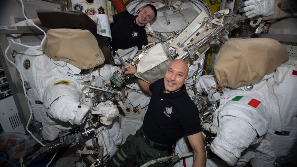 Two astronauts with their spacesuits