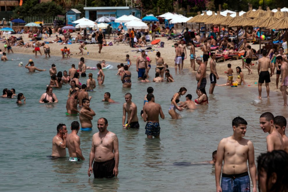 Bars, beaches and cafes packed as Europe eases coronavirus lockdowns after record-low deaths
